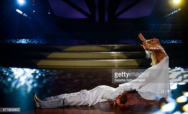 Hans Sarpei and Kathrin Menzinger perform on stage during the 7th show of the television competition 'Let's Dance' on May 1, 2015 in Cologne, Germany.
