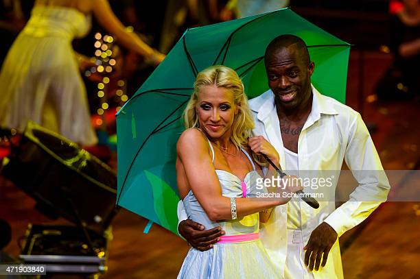 Hans Sarpei and Kathrin Menzinger react during the 7th show of the television competition 'Let's Dance' on May 1, 2015 in Cologne, Germany.