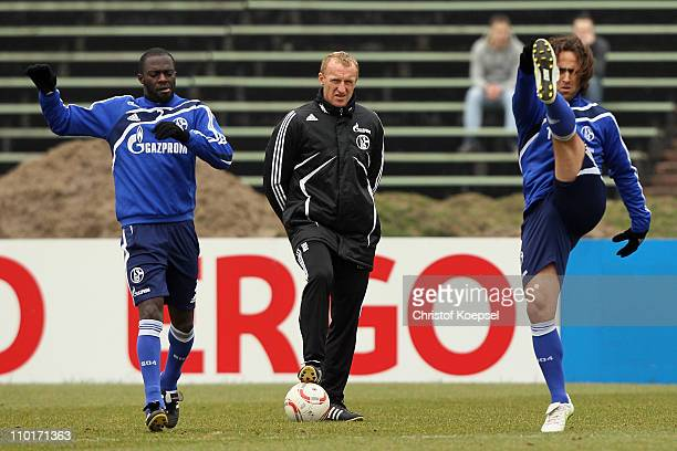 Hans Sarpei head coach Seppo Eichkorn and Ali Karimi attend the FC Schalke training session at the training ground at the Veltins Arena on March 16...