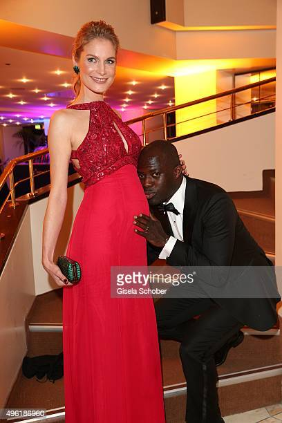 Hans Sarpei kisses the belly of his pregnant wife Pia Sarpei during the German Sports Media Ball at Alte Oper on November 7 2015 in Frankfurt am Main...
