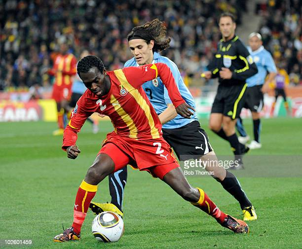 Hans Sarpei of Ghana in action against Edinson Cavani of Uruguay during the 2010 FIFA World Cup South Africa Quarter Final match between Uruguay and...