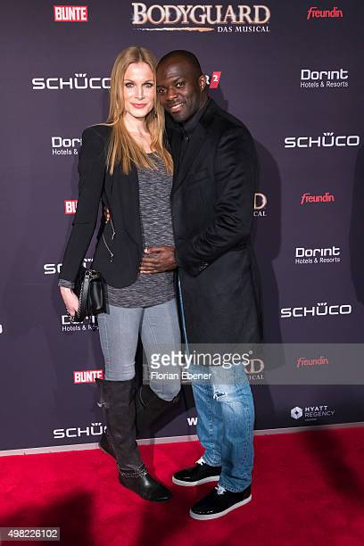 Hans Sarpei with wife Pia attend the 'Bodyguard Das Musical' gala premiere at Musical Dome Koeln on November 21 2015 in Cologne Germany