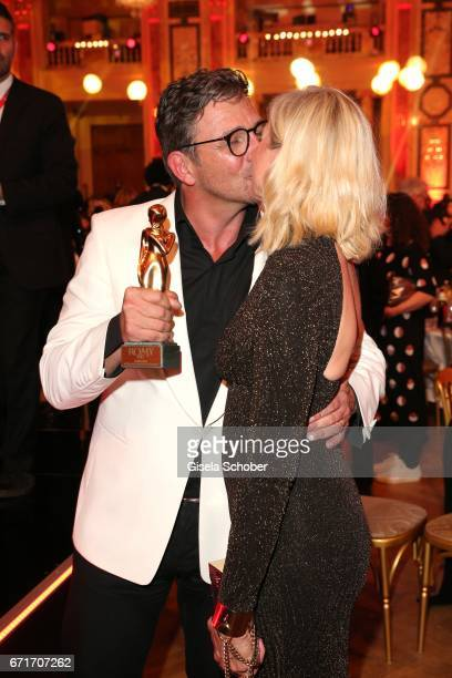 Hans Sigl and his wife Susanne Sigl with award during the ROMY award at Hofburg Vienna on April 22 2017 in Vienna Austria