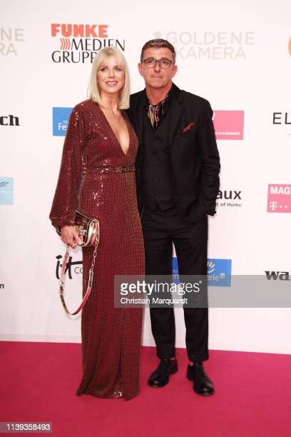 Hans Sigl and partner Susanne attend the Goldene Kamera at Tempelhof Airport on March 30 2019 in Berlin Germany