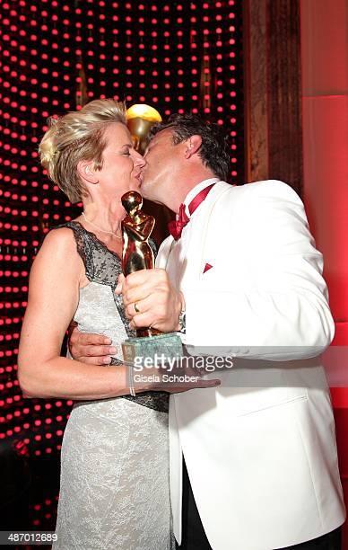 Hans Sigl kisses his wife Susanne at the 25th Romy Award 2014 at Hofburg Vienna on April 26 2014 in Vienna Austria