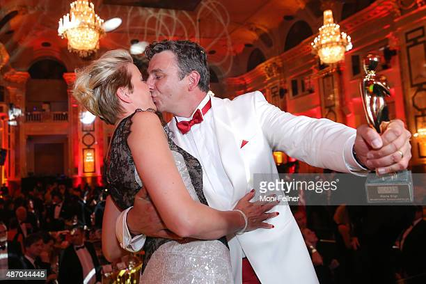 Hans Sigl kisses his wife Susanne at the Romy Award 2014 at Hofburg Vienna on April 26 2014 in Vienna Austria