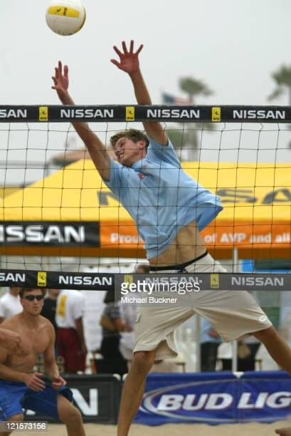Hans Stolfus jumps to block a spike during the second round of the local qualifying tournament of the Manhattan Beach Open in Manhattan Beach...