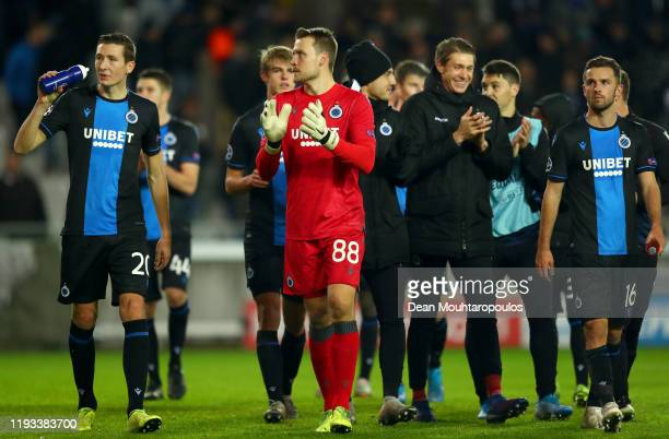 Hans Vanaken and Simon Mignolet of Club Brugge applauds fans after the UEFA Champions League group A match between Club Brugge KV and Real Madrid at...