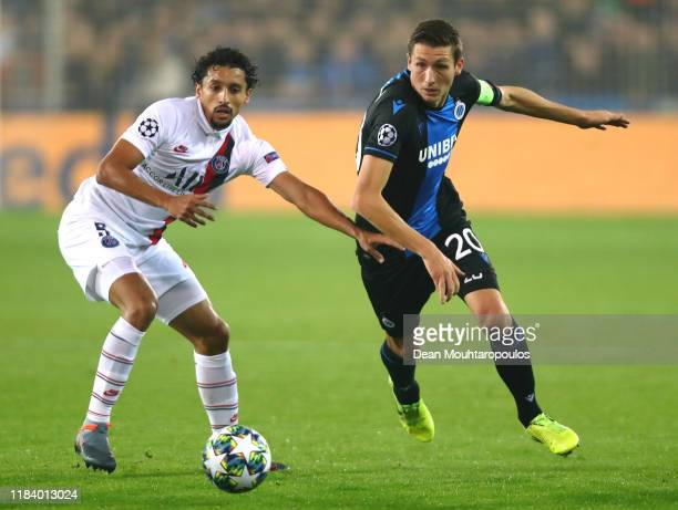 Hans Vanaken of Club Brugge KV battles for the ball with Marquinhos of PSG during the UEFA Champions League group A match between Club Brugge KV and...