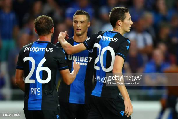 Hans Vanaken of Club Brugge KV celebrates scoring his teams first goal of the game with team mates Mats Rits and Matej Mitrovic during the UEFA...