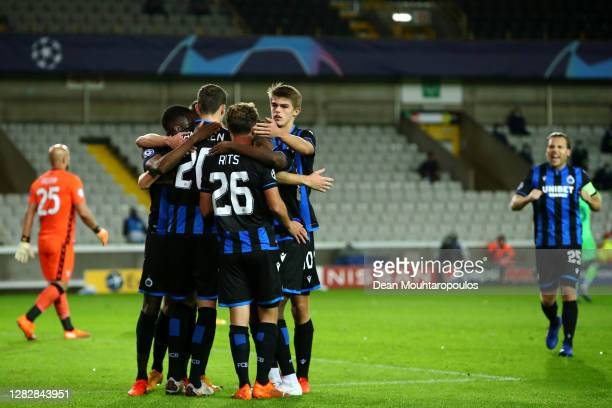 Hans Vanaken of Club Brugge KV celebrates scoring his teams first goal of the game from the penalty spot and is congratulated by team mates during...