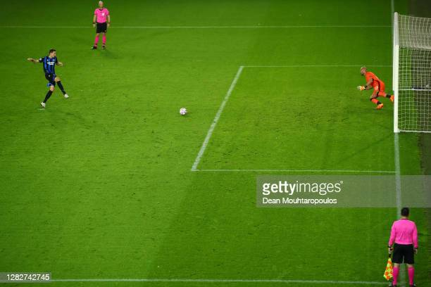 Hans Vanaken of Club Brugge KV scores his sides first goal from the penalty spot past Pepe Reina of SS Lazio during the UEFA Champions League Group F...