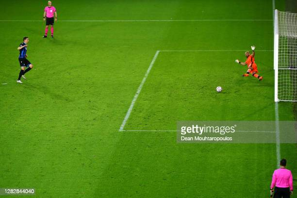 Hans Vanaken of Club Brugge KV shoots and scores his teams first goal of the game from the penalty spot past Goalkeeper, Pepe Reina of SS Lazio...