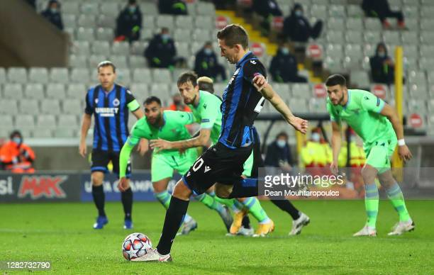 Hans Vanaken of Club Brugge scores his team's first goal from the penalty spot during the UEFA Champions League Group F stage match between Club...