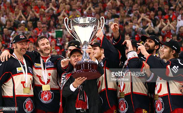 Hans Zach head coach of Hannover celebrates with the trophy after winning the DEL play off final match between Hannover Scorpions and Augsburger...