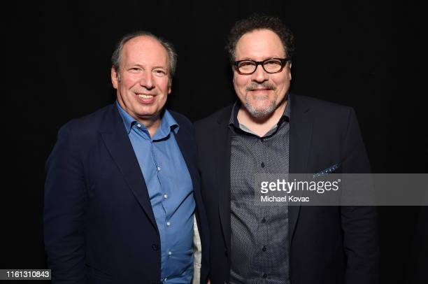 Hans Zimmer and Jon Favreau attend Twitter's fan premiere of Disney's #TheLionKing at Hollywood Highland Centre on July 10 2019 in Hollywood...
