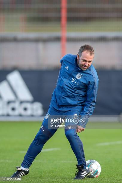 HansDieter Flick head coach of Bayern Muenchen controls the ball during a training session at Saebener Strasse training ground on March 13 2020 in...