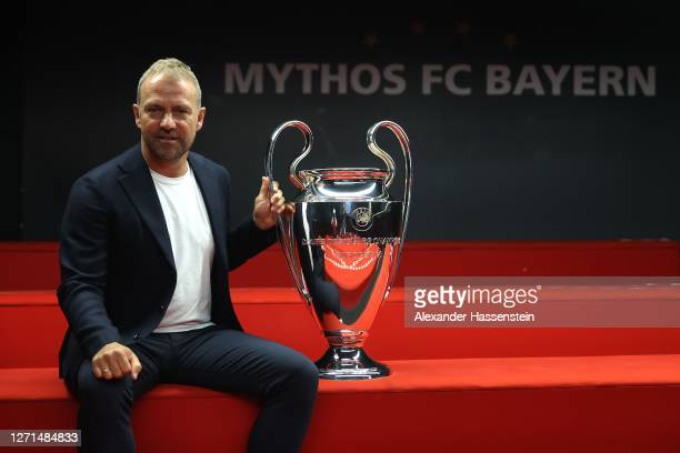 Hans-Dieter Flick, head coach of Bayern Muenchen, hands over the UEFA Champions League trophy to the FC Bayern Museum on September 09, 2020 in...