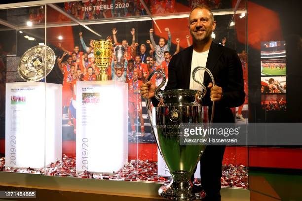 HansDieter Flick head coach of Bayern Muenchen hands over the UEFA Champions League trophy to the FC Bayern Museum on September 09 2020 in Munich...