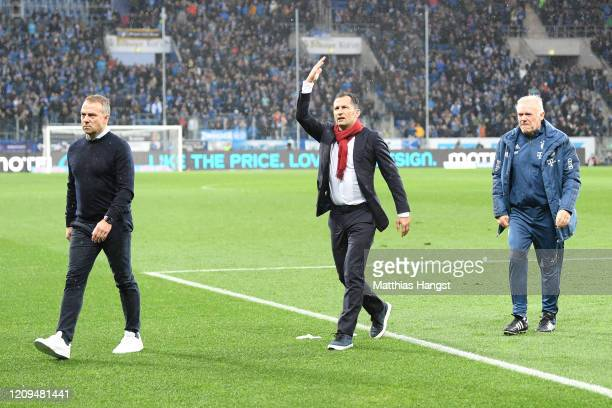 Hans-Dieter Flick, Head Coach of Bayern Munich and sporting director Hasan Salihamidzic confront the fans after demonstrations in the stands during...