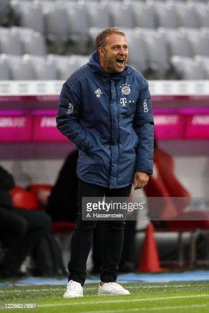 Hans-Dieter Flick, Head Coach of Bayern Munich celebrates during the Bundesliga match between FC Bayern Muenchen and Eintracht Frankfurt at Allianz...