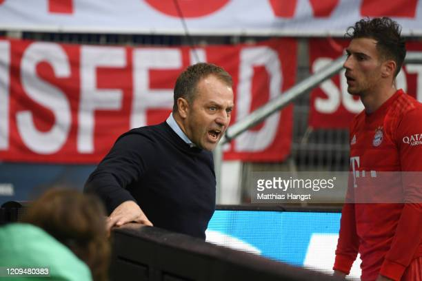 Hans-Dieter Flick, Head Coach of Bayern Munich confronts the fans during the Bundesliga match between TSG 1899 Hoffenheim and FC Bayern Muenchen at...