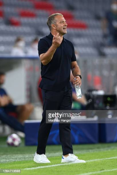 HansDieter Flick Head Coach of Bayern Munich gives his team instructions during the UEFA Champions League round of 16 second leg match between FC...