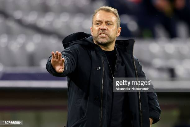 Hans-Dieter Flick, head coach of FC Bayern München gives instructions during to the UEFA Champions League Round of 16 match between Bayern München...