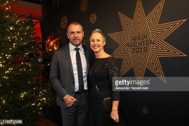HansDieter Flick head coach of FC Bayern Muenchen attends with his wife Silke Flick the clubs Christmas party at Allianz Arena on December 08 2019 in...