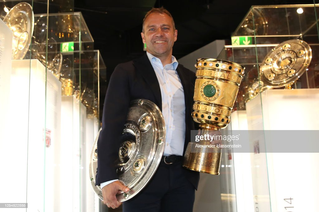 Hans-Dieter Flick Hands Over Championship And DFB Cup Trophy To FCB Erlebniswelt : News Photo