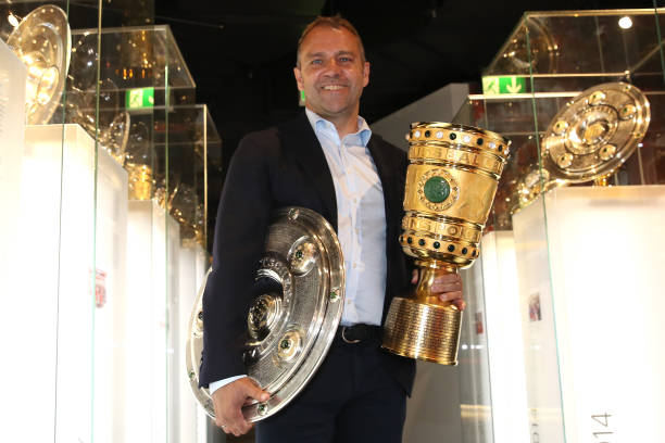 DEU: Hans-Dieter Flick Hands Over Championship And DFB Cup Trophy To FC Bayern Museum