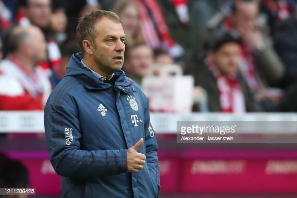 Hans-Dieter Flick, head coach of FC Bayern Muenchen reacts during the Bundesliga match between FC Bayern Muenchen and FC Augsburg at Allianz Arena on...