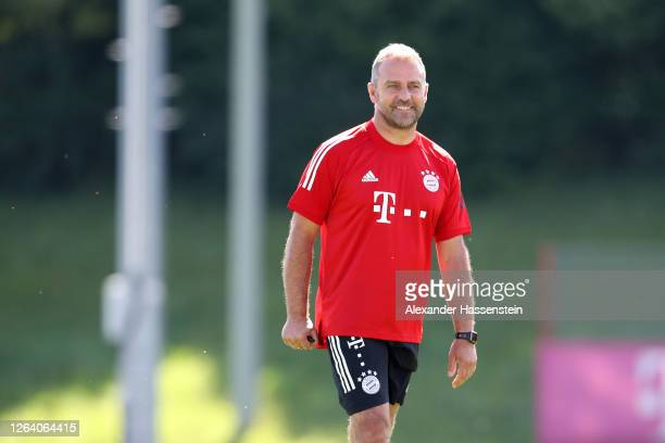 Hans-Dieter Flick, head coach of FC Bayern Muenchen smiles during a training session at Saebener Strasse training ground on August 05, 2020 in...