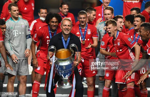 Hans-Dieter Flick, Head Coach of FC Bayern Munich celebrates with the UEFA Champions League Trophy following his team's victory in the UEFA Champions...