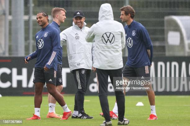 Hans-Dieter Flick, Head Coach of Germany talks to his players during a training session at ADM-Sportpark on August 30, 2021 in Stuttgart, Germany.