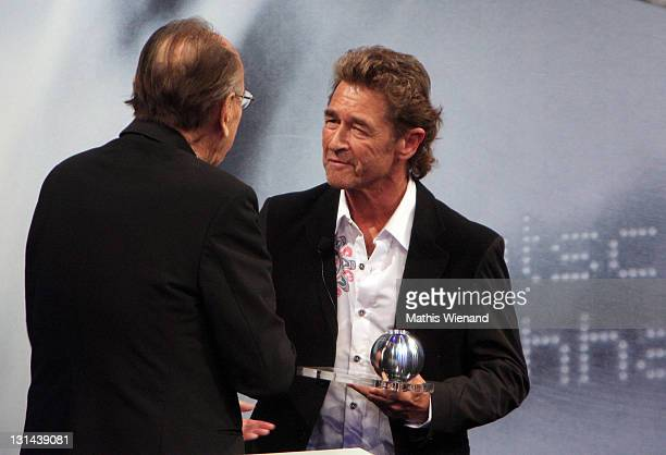 HansDietrich Genscher and Peter Maffay as he accepts his Nachhaltigkeitspreis award during the Nachhaltigkeitspreis Gala at Maritim Hotel on November...