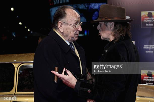 HansDietrich Genscher and singer Udo Lindenberg arrive for the 'Hinterm Horizont' musical premiere at Theater am Potsdamer Platz on January 13 2011...