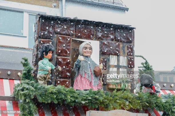 Hansel and Gretel and the old witch at her ginger bread house The worldfamous Christmas Market of Nuremberg was full of people even if there was...