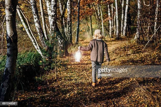Hansel and Gretel, Boy walking in forest, carrying lantern