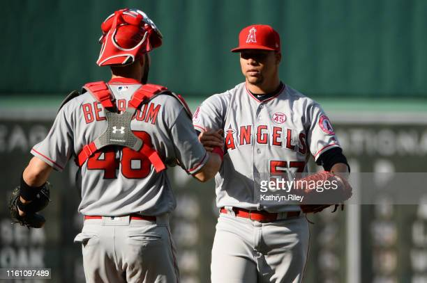 Hansel Robles celebrates with teammate Anthony Bemboom of the Los Angeles Angels after defeating the Boston Red Sox in the tenth inning at Fenway...