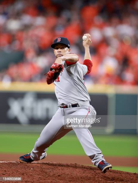 Hansel Robles of the Boston Red Sox pitches against the Houston Astros in the seventh inning during Game One of the American League Championship...