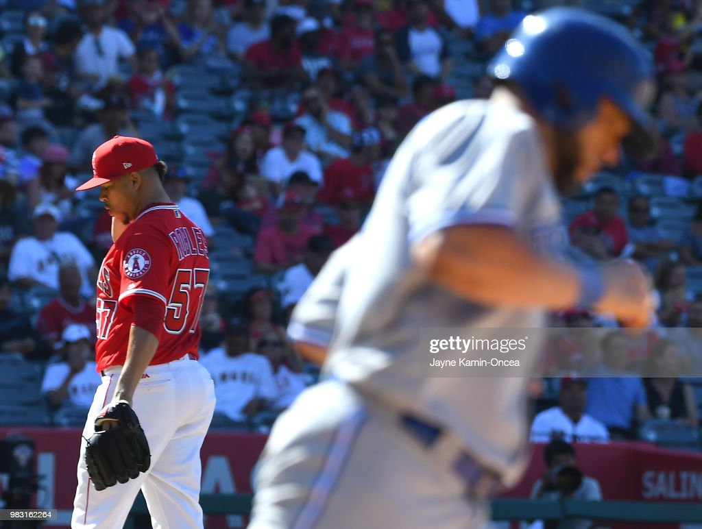 Hansel Robles #57 of the Los Angeles Angels of Anaheim stands on the mound after giving up the game winning home run to Kendrys Morales #8 of the Toronto Blue Jays in the tenth inning of the game at Angel Stadium on June 24, 2018 in Anaheim, California.