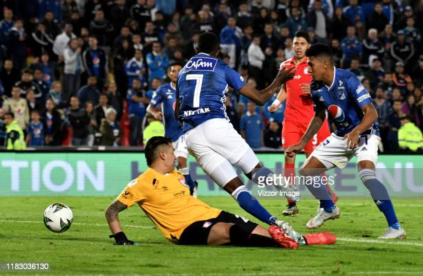 Hansel Zapata Sebastián Salazar of Millonarios and Leandro Castellanos of Independiente Santa Fe figth for the ball during a match between...
