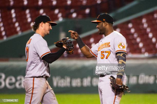 Hanser Alberto celebrates with teammate Austin Hays of the Baltimore Orioles after beating the Boston Red Sox at Fenway Park on September 24, 2020 in...