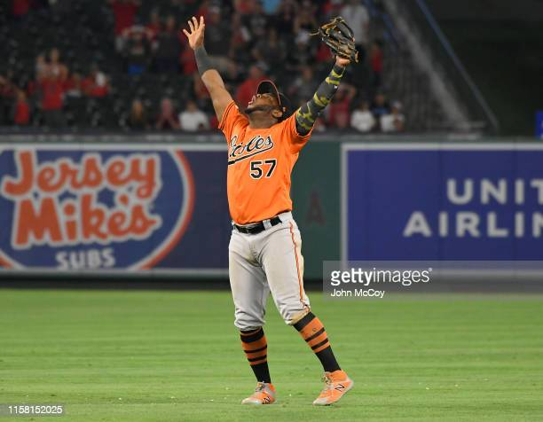 Hanser Alberto of the Baltimore Orioles celebrates after catching a pop fly hit by Justin Upton of the Los Angeles Angels of Anaheim to end the game...