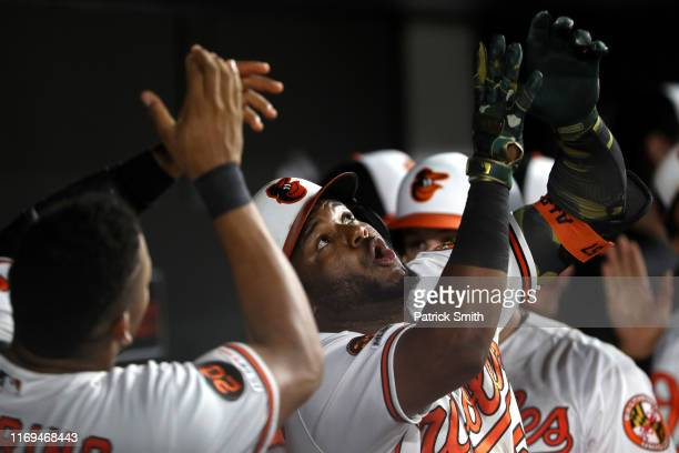 Hanser Alberto of the Baltimore Orioles celebrates his three run home run in the dugout with teammates against the Kansas City Royals during the...