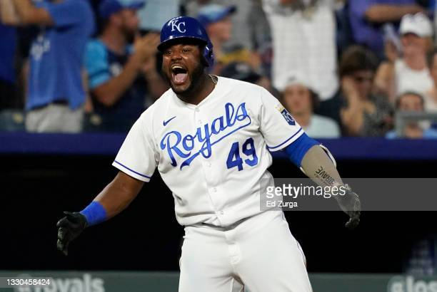 Hanser Alberto of the Kansas City Royals celebrates his two-run triple in the seventh inning against the Detroit Tigers at Kauffman Stadium on July...