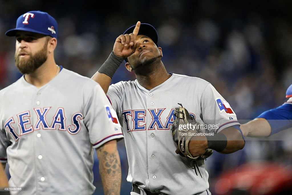 Hanser Alberto #68 of the Texas Rangers celebrates after defeating the Toronto Blue Jays 6-4 during game two of the American League Division Series at Rogers Centre on October 9, 2015 in Toronto, Canada.