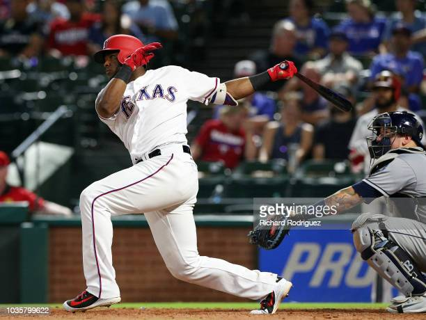 Hanser Alberto of the Texas Rangers hits a double in the eighth inning against the Tampa Bay Rays at Globe Life Park in Arlington on September 18...