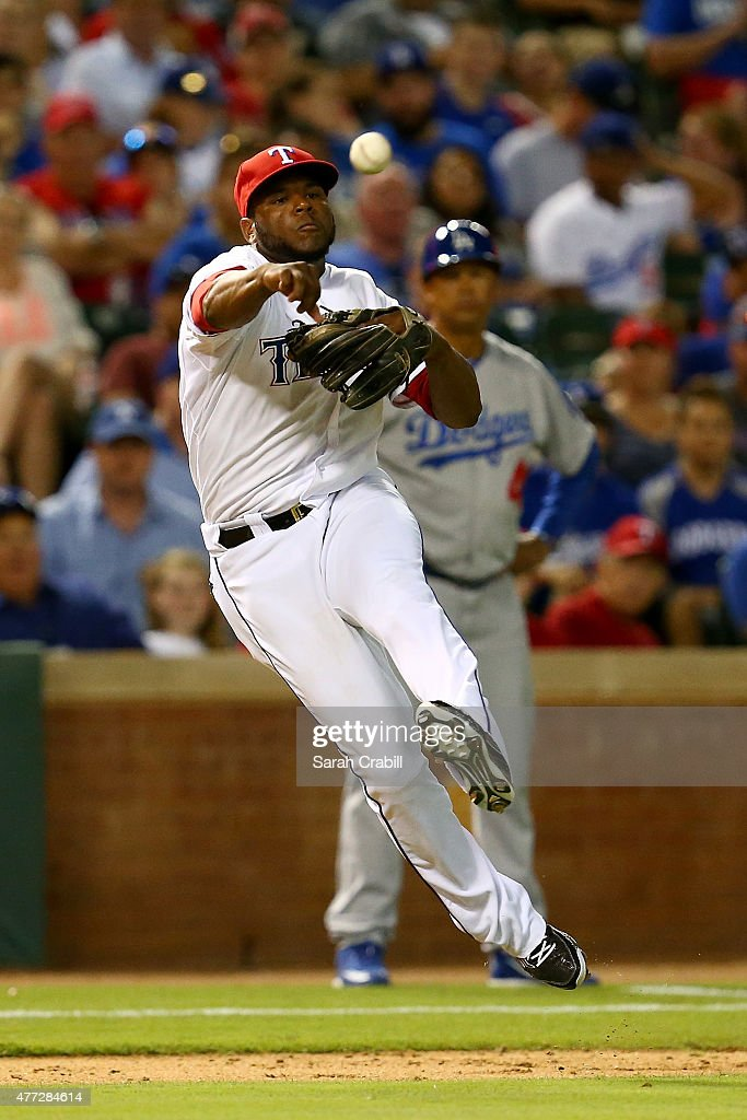 Hanser Alberto #68 of the Texas Rangers overthrows first base in the seventh inning during a game against the Los Angeles Dodgers at Globe Life Park in Arlington on June 15, 2015 in Arlington, Texas. The Texas Rangers defeated the Los Angeles Dodgers 4-1.